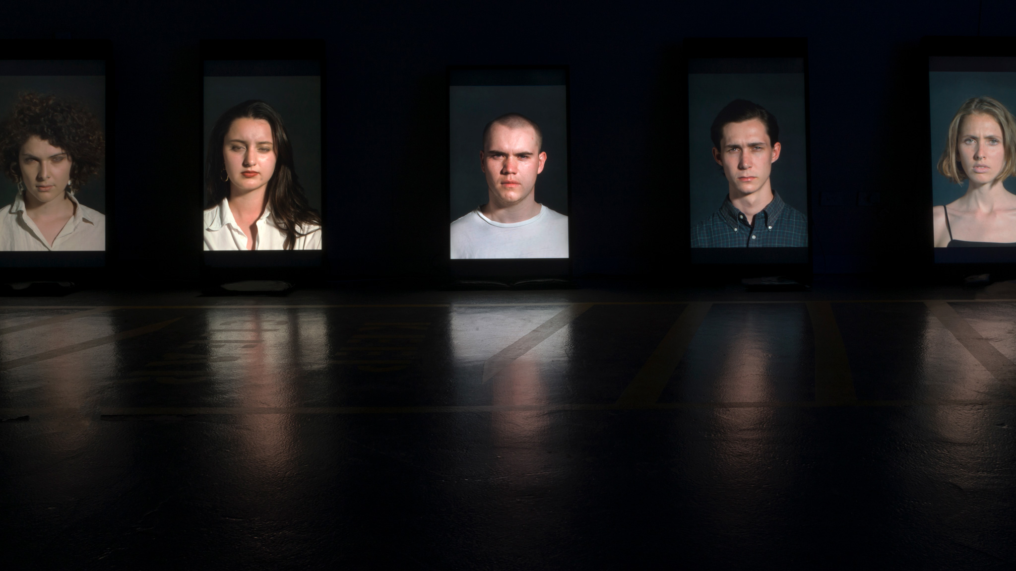 <p><i>Flash Portraits</i>, 2018, 5 Channel Installation, Vertically Orientated LCD Screens, 1200mm x 700mm, Installation View, U.T.S Studios 2018</p>