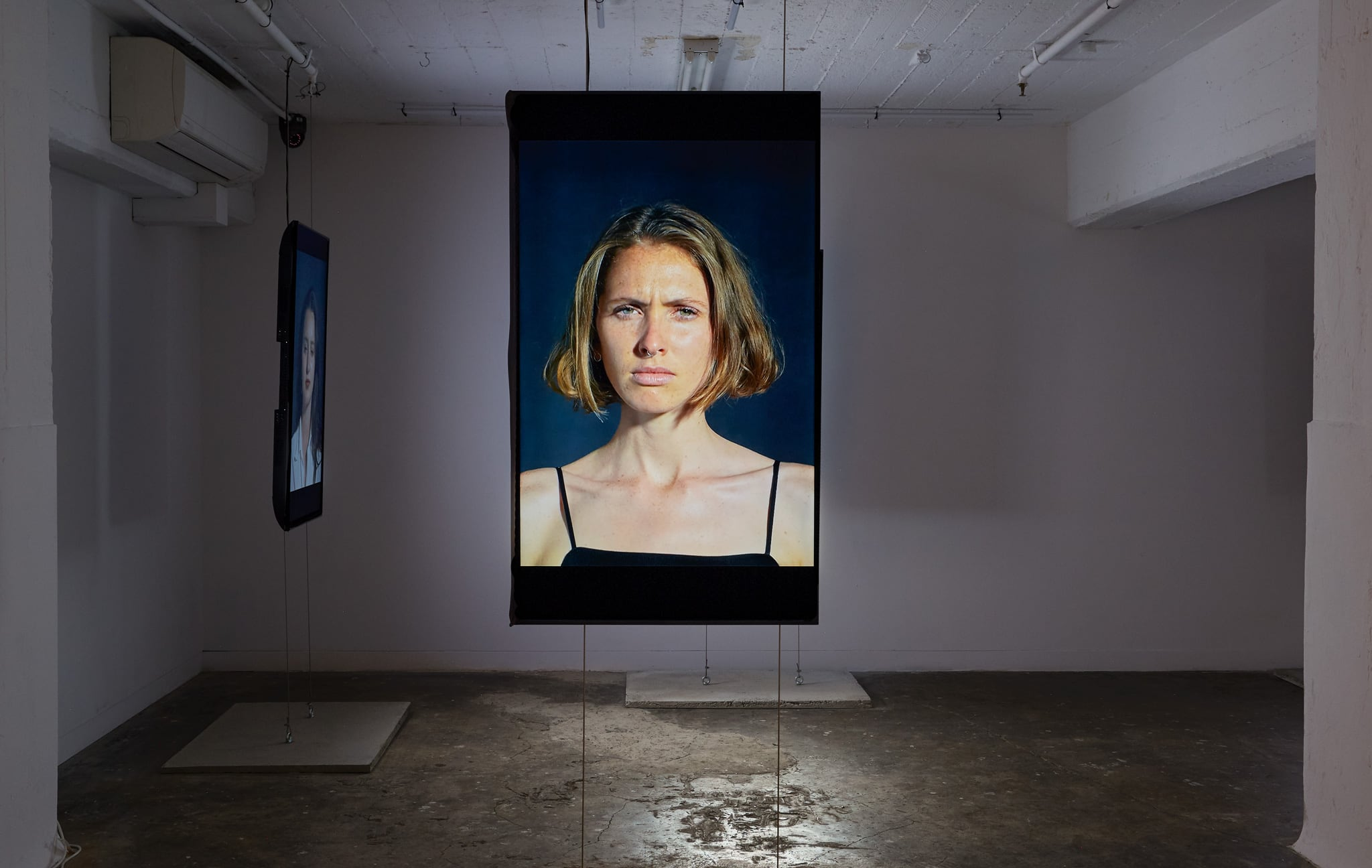 <p><i>Flash Portraits</i>, 2018, 5 channel installation, vertically orientated LCD screens, 1200 x 700mm, Installation View, DownUnder Gallery 2018</p>