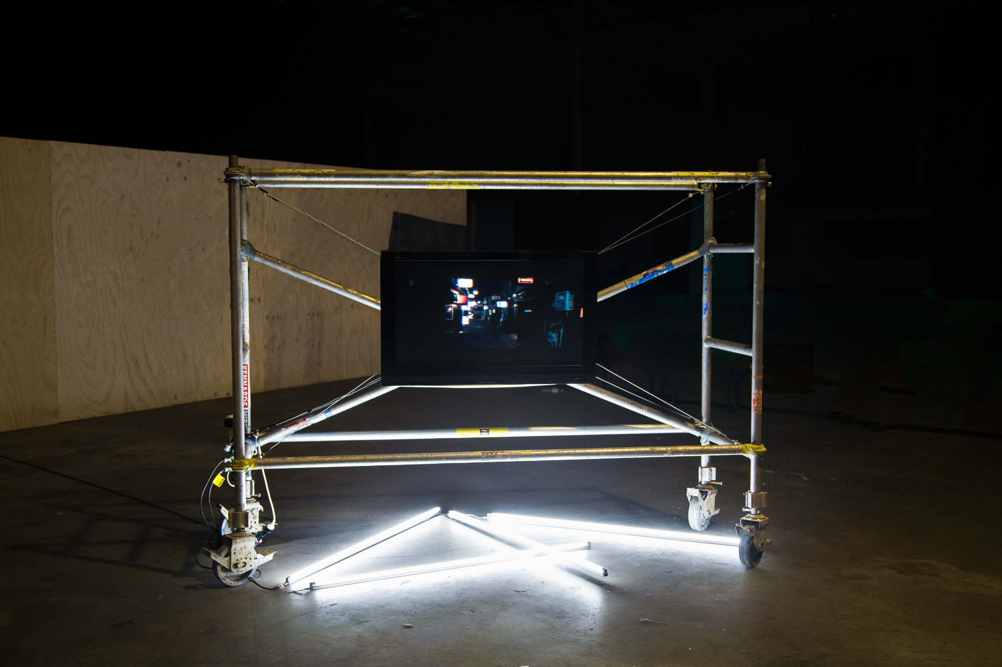 <p><i>Metropolis</i>, 2016, Single channel HD video, Continuous Loop 2:40 mins. LCD Screen 1200mm x 800mm, Scaffolding, Metal Rope, Fluro Bar. Installation view, Sydney Fringe Festival, 2017. </p>